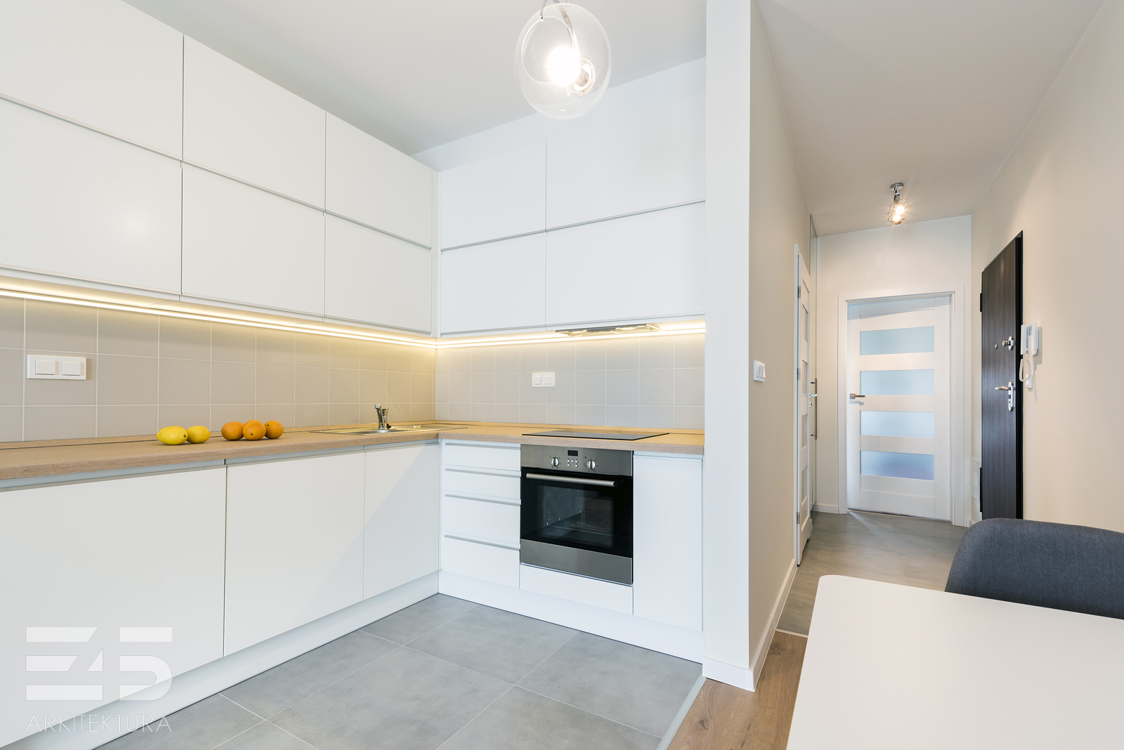 Modern kitchen interior design in white finishing in small apartment